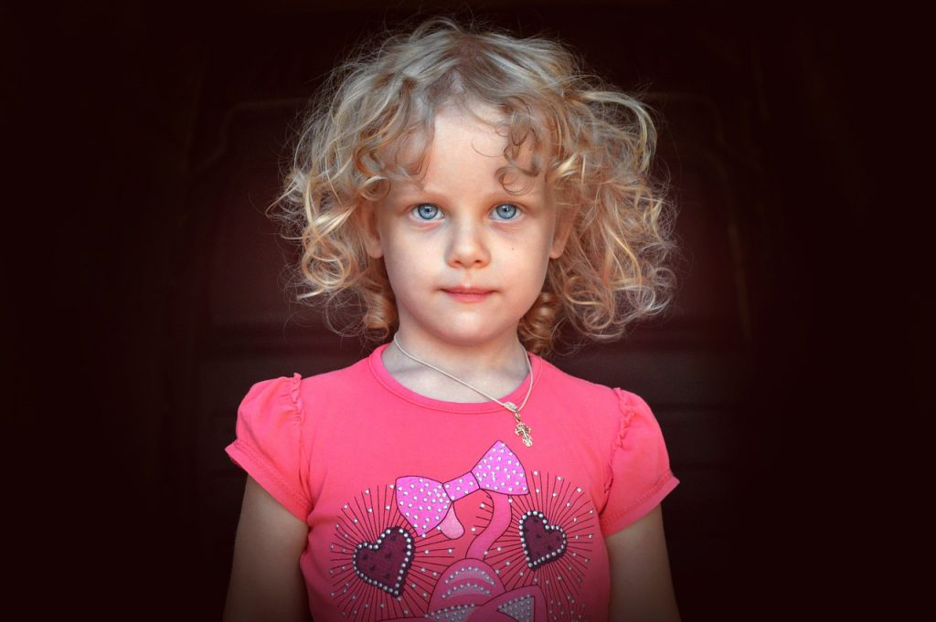 A blonde girl with curly hair