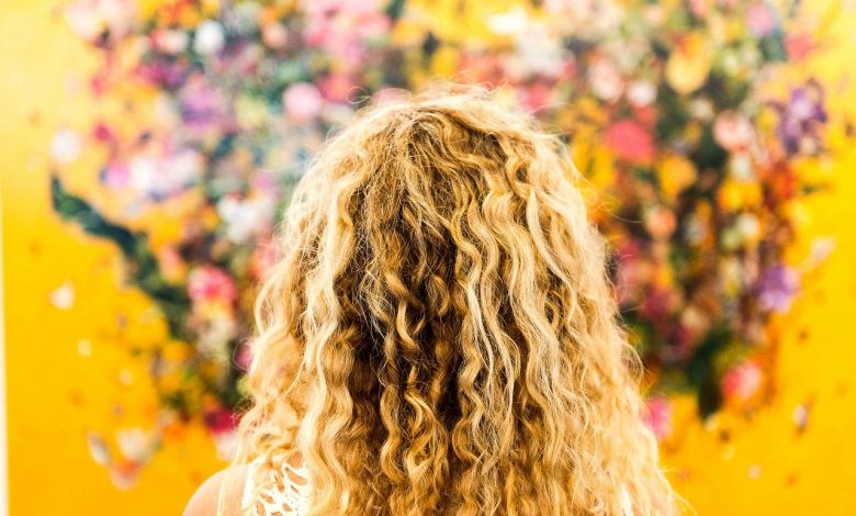 A lady with blonde curly hair