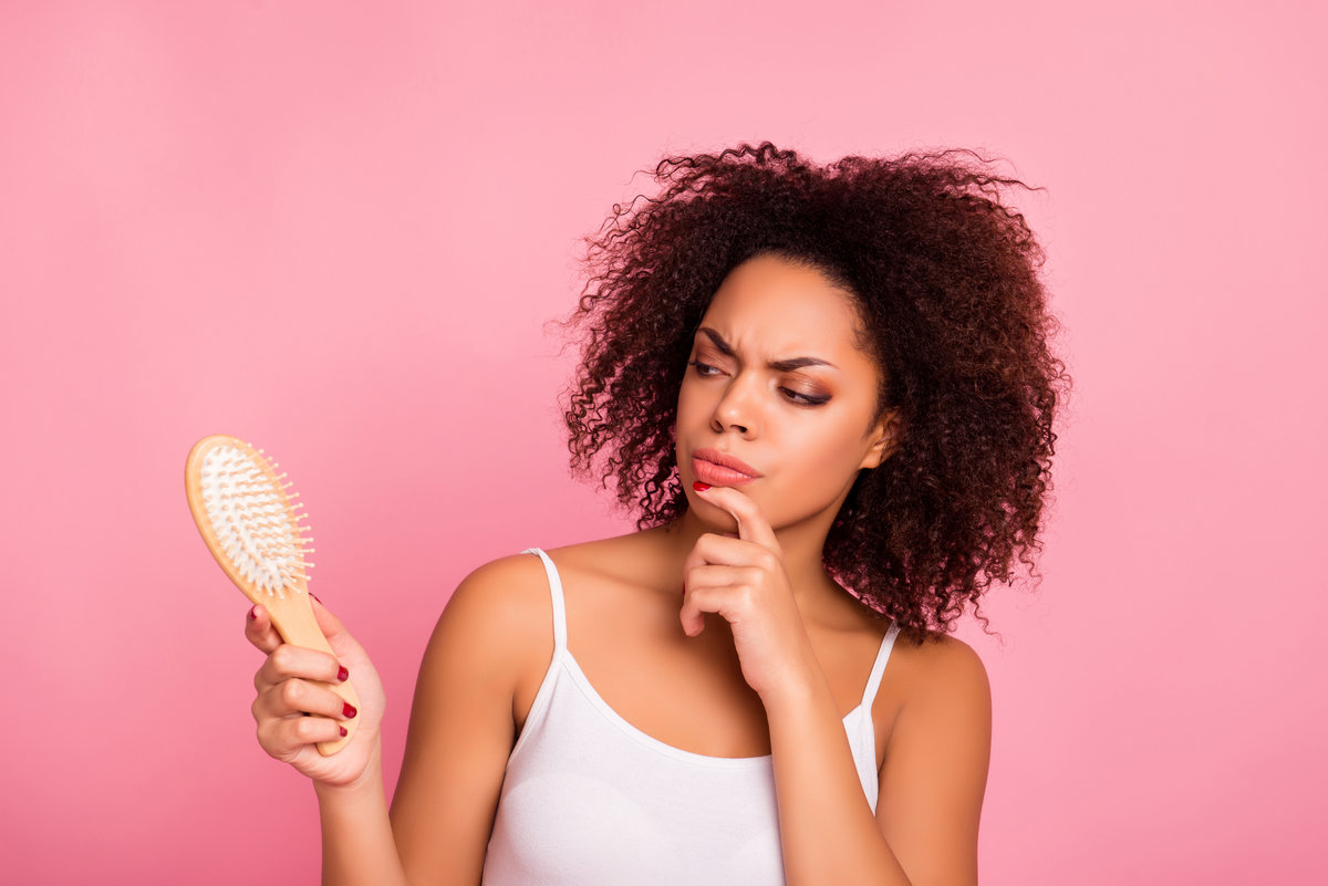 A woman brushing her hair