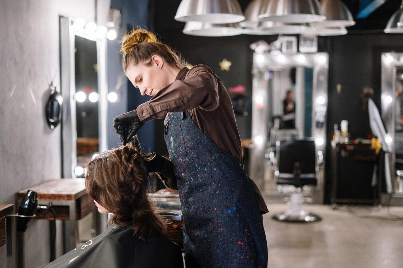 Woman getting a haircut at the salon
