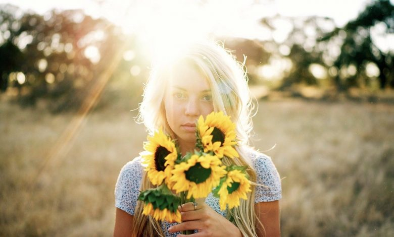 A woman with the sun shining on her hair