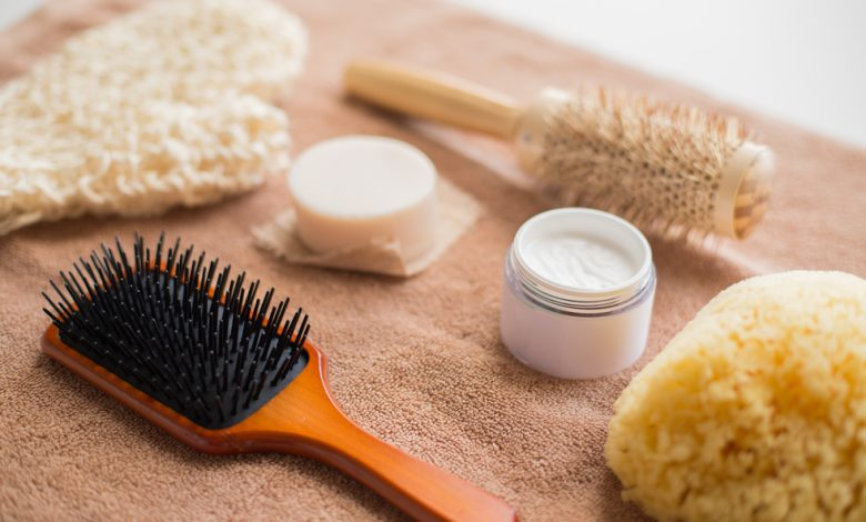 A hair brush on a towel