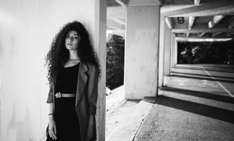 A black and white photo of a girl with curly hair