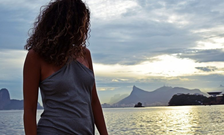 A Brazilian woman in front of the sea