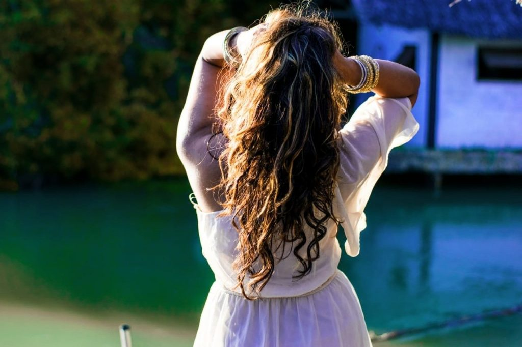 A girl with her hands in her hair