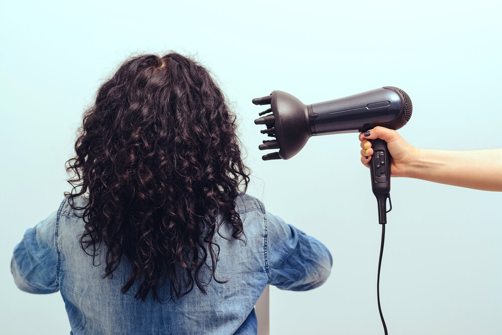 A woman with a hair diffuser