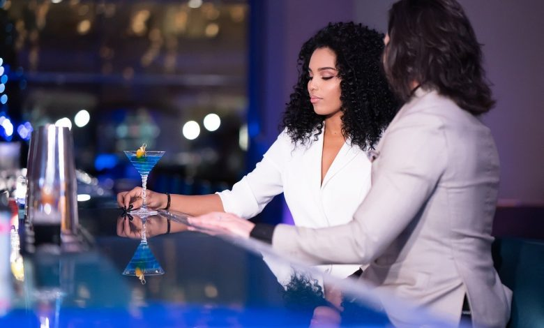 A girl with Peruvian curly hair in a bar