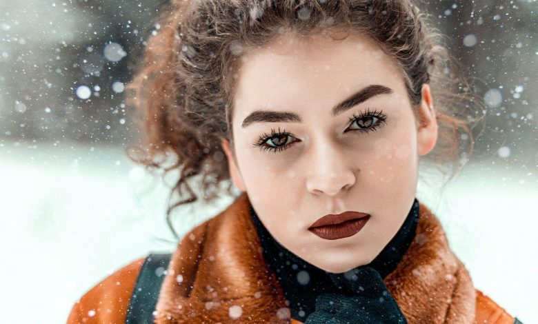 A girl with curly hair outside in the snow
